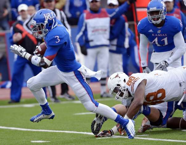 Kansas running back Tony Pierson (3) sprints past Texas defensive end Cedric Reed (88) for a touchdown during the first half of an NCAA college football game in Lawrence, Kan., Saturday, Oct. 27, 2012. (AP Photo/Reed Hoffmann) (Associated Press)