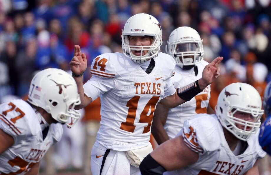 Texas quarterback David Ash (14) calls out instructions to his team during the first half of an NCAA college football game against Kansas in Lawrence, Kan., Saturday, Oct. 27, 2012. (AP Photo/Reed Hoffmann) (Associated Press)