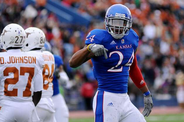 Kansas safety Brandon McDougald reacts after making a tackle against the Texas during the first half of NCAA football game, Saturday, Oct. 27,2 012, in Lawrence, Kansas. (AP Photo/The Daily Texan, Lawrence Peart) (Associated Press)