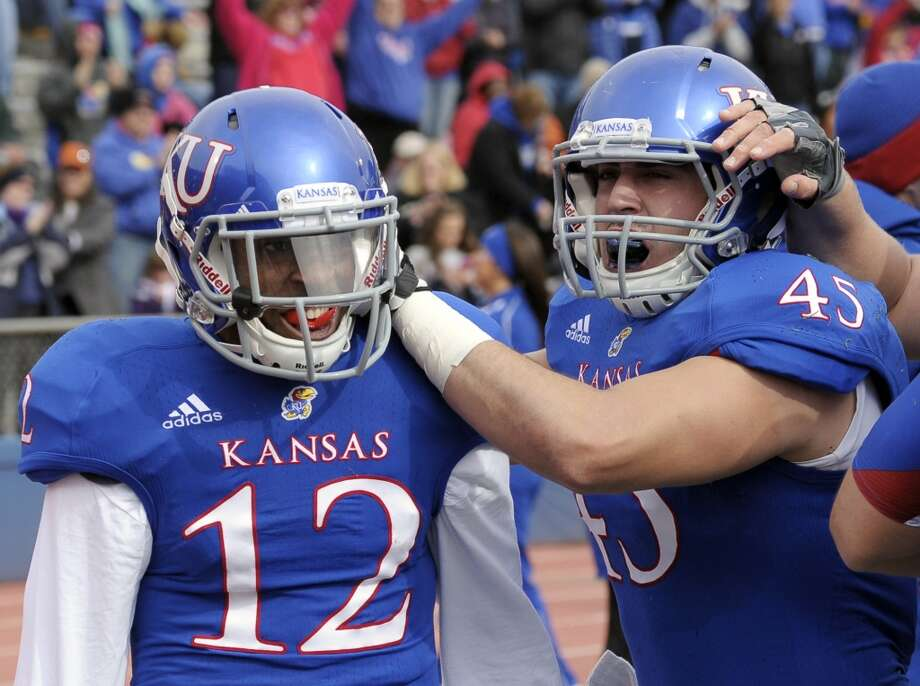 Kansas wide receiver Christian Matthews (12) is congratulated by teammate Nick Sizemore (45) after scoring a touchdown during the first half of an NCAA college football game against Texas in Lawrence, Kan., Saturday, Oct. 27, 2012. (AP Photo/Reed Hoffmann) (Associated Press)