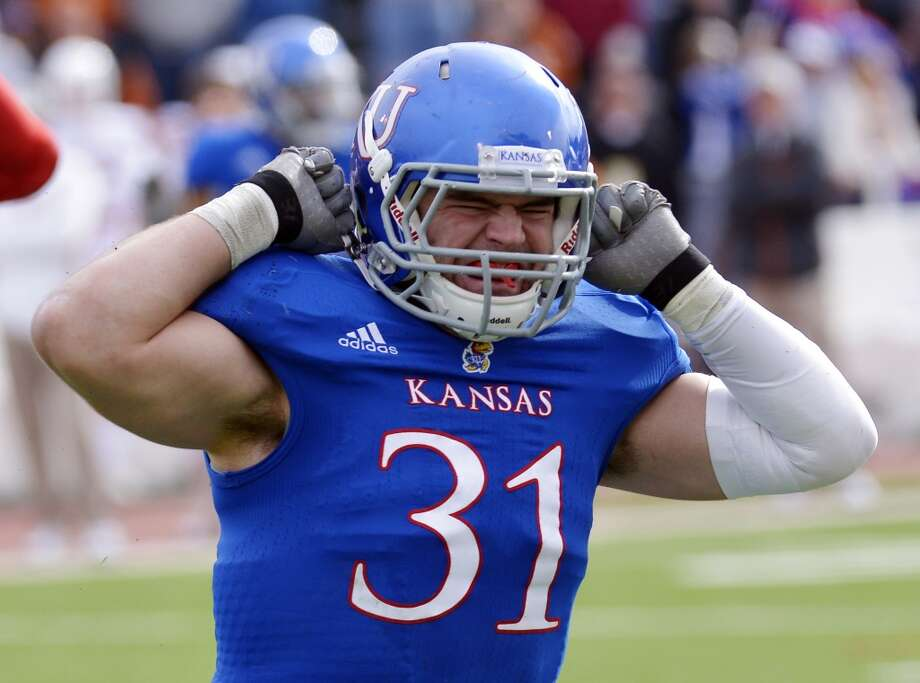 Kansas linebacker Ben Heeney (31) reacts in frustration after missing an interception against Texas during the first half of an NCAA college football game in Lawrence, Kan., Saturday, Oct. 27, 2012. (AP Photo/Reed Hoffmann) (Associated Press)