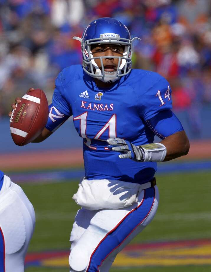 Kansas quarterback Michael Cummings (14) looks to pass against Texas during the second half of an NCAA college football game in Lawrence, Kan., Saturday, Oct. 27, 2012. (AP Photo/Reed Hoffmann) (Associated Press)