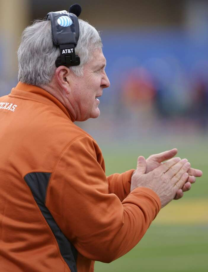 Texas head coach Mack Brown cheers on his team after a touchdown against the Kansas during the first half of an NCAA college football game in Lawrence, Kan., Saturday, Oct. 27, 2012. (AP Photo/Reed Hoffmann) (Associated Press)