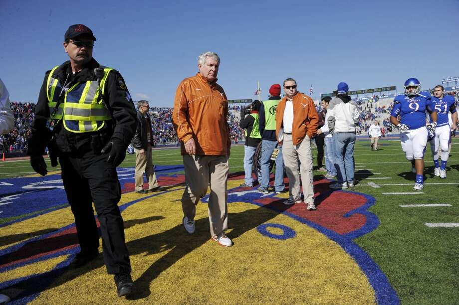 Texas head coach Mack Brown leaves the field after narrowly defeating Kansas 21-17 in an NCAA college football game in Lawrence, Kan., Saturday, Oct. 27, 2012. (AP Photo/Reed Hoffmann) (Associated Press)