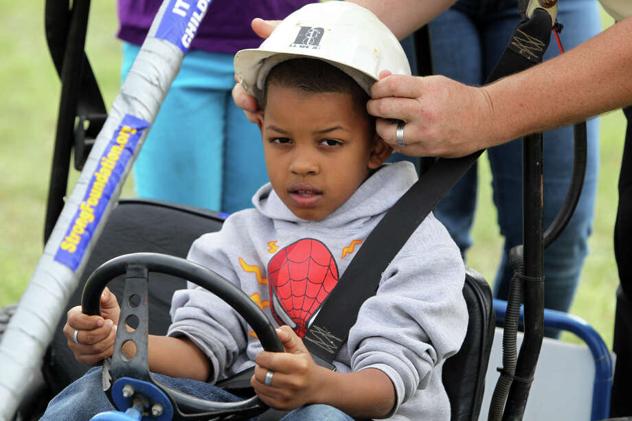 Joseph Grant, 7, prepares to race the Strong Foundation Ministries cart during the 8th Annual Dignowity Hill Push Cart Derby at Dignowity Hill Park, Saturday, October 27, 2012. Photo: Jennifer Whitney, For The Express-News / © Jennifer Whitney