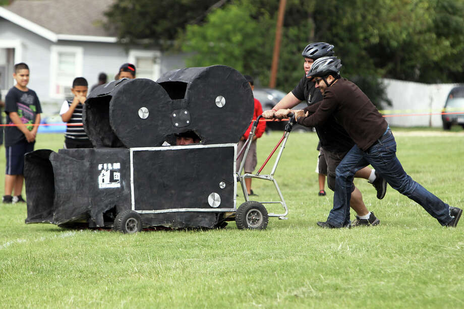 The SA Film Commission races a camera card made of paper macho over a wood and wire frame during the 8th Annual Dignowity Hill Push Cart Derby at Dignowity Hill Park, Saturday, October 27, 2012. Photo: Jennifer Whitney, For The Express-News / © Jennifer Whitney