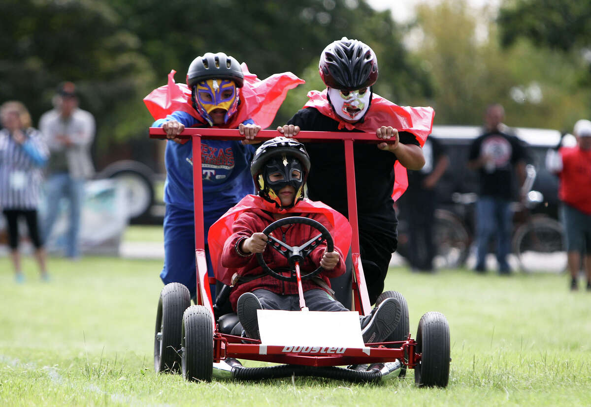 The Bowdoin Elementary Little Luchares race in an early round during the 8th Annual Dignowity Hill Push Cart Derby at Dignowity Hill Park, Saturday, October 27, 2012.