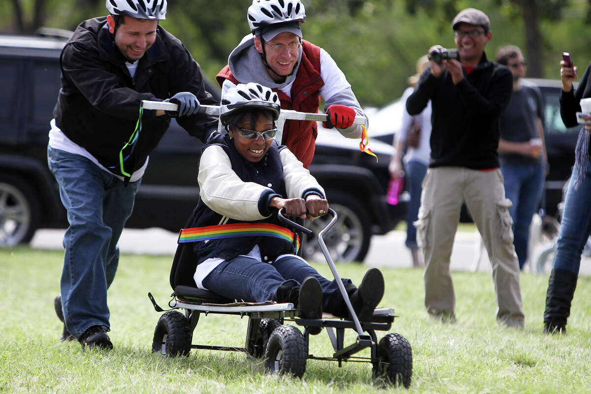 Councilwoman Ivy Taylor is pushed by her staff during the 8th Annual Dignowity Hill Push Cart Derby at Dignowity Hill Park, Saturday, October 27, 2012.
