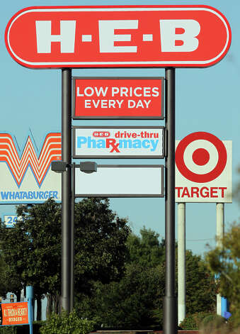 A Target sign is near an H-E-B sign on Southeast Military Drive near Brooks City-Base. H-E-B plans to adapt to increasing competition from stores like Target and Wal-Mart. Photo: John Davenport, San Antonio Express-News / San Antonio Express-News