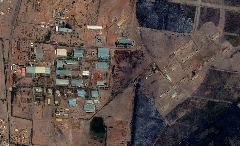 "The Yarmouk military complex in Khartoum, Sudan seen in a satellite image made on October 12 2012, prior to the alleged attack. A U.S. monitoring group says satellite images of the aftermath of an explosion at a Sudanese weapons factory suggest the site was hit by an airstrike. The Sudanese government has accused Israel of bombing its Yarmouk military complex in Khartoum, killing two people and leaving the factory in ruins.The images released by the Satellite Sentinel Project to The Associated Press on Saturday Oct 27 2012 showed several 52-foot wide craters. A spokesman for the project said military experts found the craters to be ""consistent with large impact craters created by air-delivered munitions."" Israeli officials have neither confirmed nor denied striking the site, instead accusing Sudan of playing a role in an Iranian-backed network of arms shipments to Hamas and Hezbollah.  (AP Photo/ DigitalGlobe via Satellite Sentinel Project) Photo: HOPD / DigitalGlobe"
