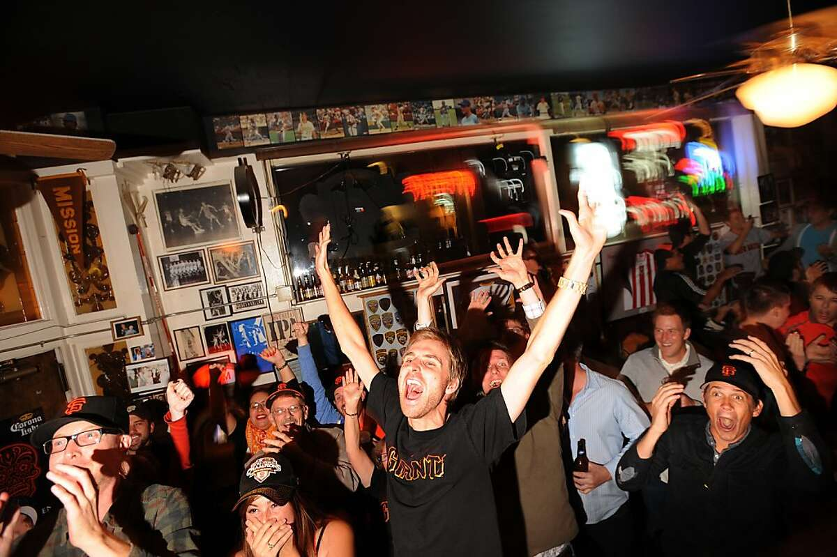 At Double Play Bar and Grill, Tyler Costin exults as Pablo Sandoval scores in the first World Series game.