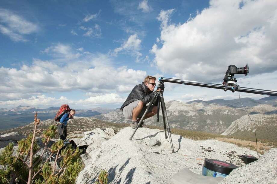As Colin Delehanty, left, reorganizes his backpack before hiking to a higher altitude to photograph a sunset time lapse sequence, Sheldon Neill takes images with his iPhone in between filming time lapses. Photo: Alejandra Bayardo, Staff / SFC