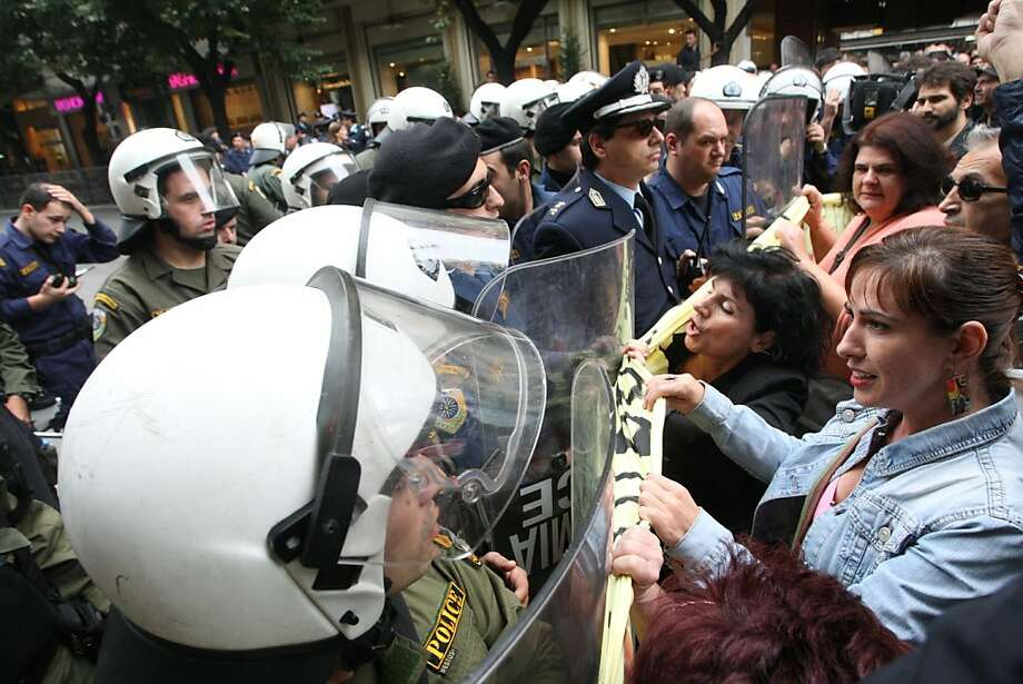 Riot police scuffle with anti-austerity demonstrators taking part in a protest against austerity measures as part of an annual student parade commemorating the nation's entry into World War II, in Thessaloniki, on October 27, 2012. Photo: Sakis Mitrolidis, AFP/Getty Images