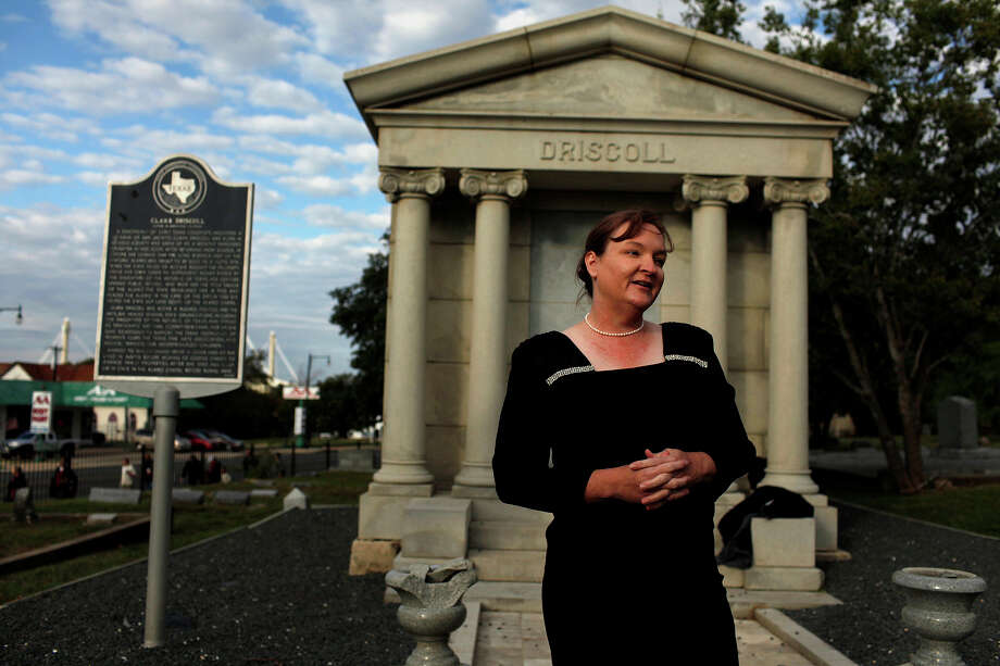 Sherri Driscoll, museum educator for the Alamo, portrays Alamo advocate Clara Driscoll (no relation) in front of her grave during the Eastside Cemeteries Tour. Photo: Lisa Krantz, Express-News / © 2012 San Antonio Express-News