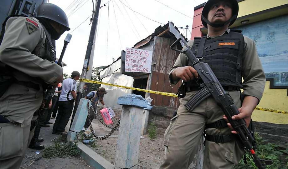 Members of Indonesia's antiterrorism squad secure a suspect's house during a raid in Mojosongo in central Java. Officers conducted raids in four provinces. Photo: Anwar Mustafa, AFP/Getty Images