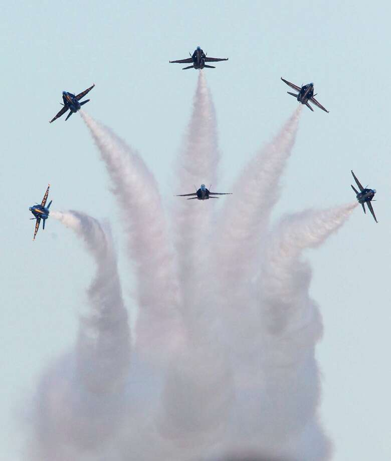 The Blue Angels, U.S. Navy's Flight Demonstration Squadron, perform during the 28th Annual Wings Over Houston Airshow at  Ellington Field on Saturday, Oct. 27, 2012, in Houston. Photo: Mayra Beltran, Houston Chronicle / Houston Chronicle