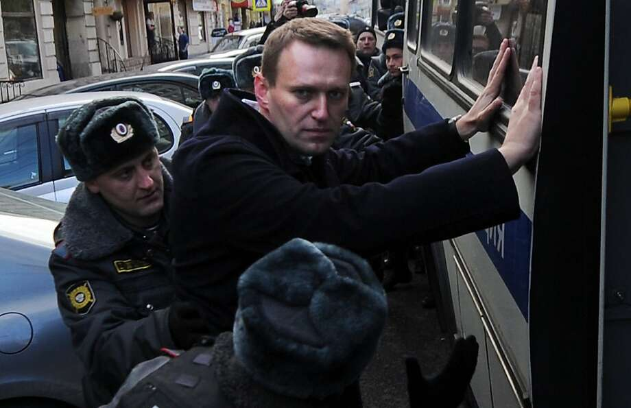 Russian anticorruption campaigner and blogger Alexei Navalny is detained by the police during a protest staged in central Moscow by about 200 people against the latest wave of arrests. Photo: Andrey Smirnov, AFP/Getty Images