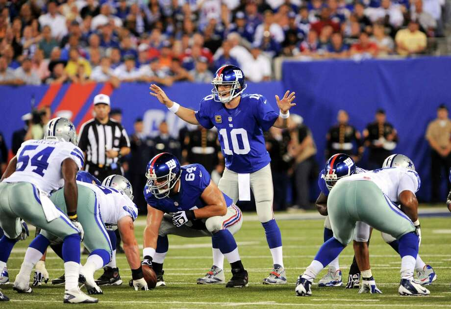 Giants quarterback Eli Manning (10) in action against the Cowboys at MetLife Stadium in East Rutherford, N.J., Sept. 5, 2012. Photo: BARTON SILVERMAN, New York Times / NYTNS