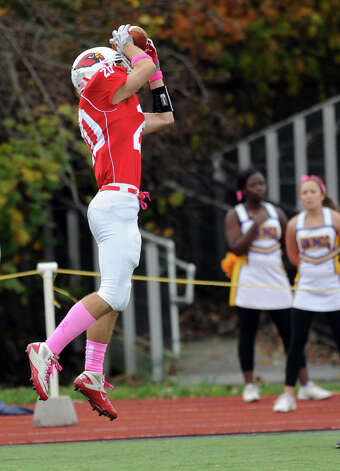 Greenwich's Shawn Dunster catches an interception during Saturday's football game at Westhill High School on October 27, 2012. Photo: Lindsay Niegelberg