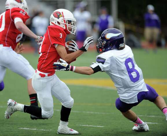Greenwich's Austin Longi is tackled by Westhill's Dante Fargnoli during Saturday's football game at Westhill High School on October 27, 2012. Photo: Lindsay Niegelberg