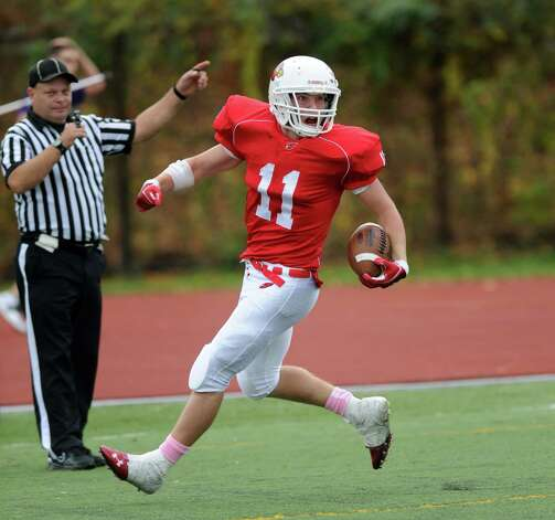 Greenwich's Alex McMurray scores a touchdown during Saturday's football game at Westhill High School on October 27, 2012. Photo: Lindsay Niegelberg