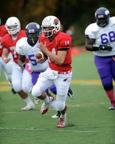 Greenwich's Liam O'Neil carries the ball during Saturday's football game at Westhill High School on October 27, 2012. Photo: Lindsay Niegelberg