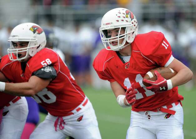 Greenwich's Alex McMurray carries the ball during Saturday's football game at Westhill High School on October 27, 2012. Photo: Lindsay Niegelberg