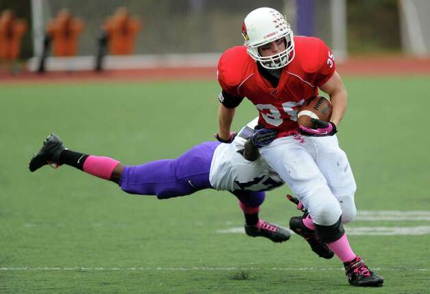 Greenwich's Mark Bernstein carries the ball during Saturday's football game at Westhill High School on October 27, 2012. Photo: Lindsay Niegelberg