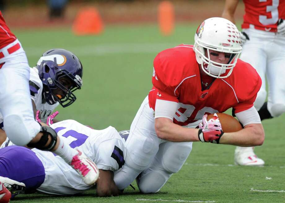 Greenwich's Joe Kelly carries the ball during Saturday's football game at Westhill High School on October 27, 2012. Photo: Lindsay Niegelberg