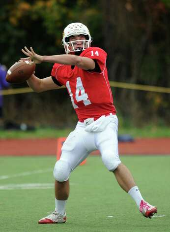 Greenwich's Liam O'Neil throws a pass during Saturday's football game at Westhill High School on October 27, 2012. Photo: Lindsay Niegelberg