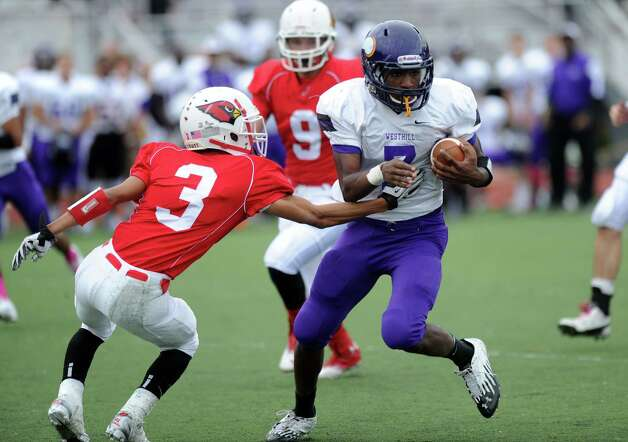 Westhill's Davell Cotterell carries the ball during Saturday's football game against Greenwich High School at Westhill High School on October 27, 2012. Photo: Lindsay Niegelberg
