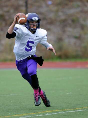 Westhill's Ryan Coppola looks to pass during Saturday's football game against Greenwich High School at Westhill High School on October 27, 2012. Photo: Lindsay Niegelberg