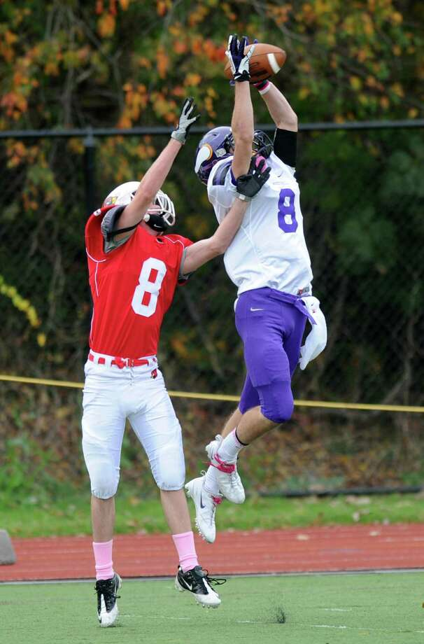 Westhill's Dante Gargnoli and Greenwich's Nicholas Pulitano reach for a pass that fell incomplete during Saturday's football game at Westhill High School on October 27, 2012. Photo: Lindsay Niegelberg