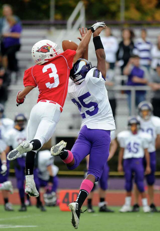 Westhill's Yveson Cassamajor and Greenwich's Austin Longi reach for a pass that fell incomplete during Saturday's football game at Westhill High School on October 27, 2012. Photo: Lindsay Niegelberg