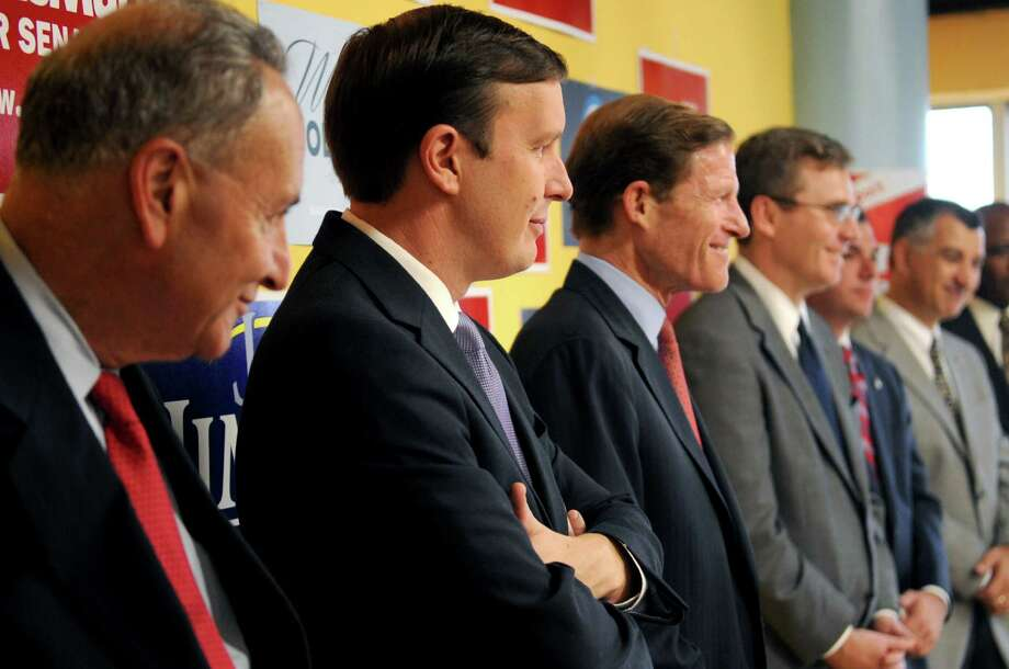U.S. Rep. Chris Murphy, democratic candidate for U.S. Senate, listens as politicians speak in support of his campaign at the Stamford democratic headquarters on Friday, October 19, 2012. Photo: Lindsay Niegelberg