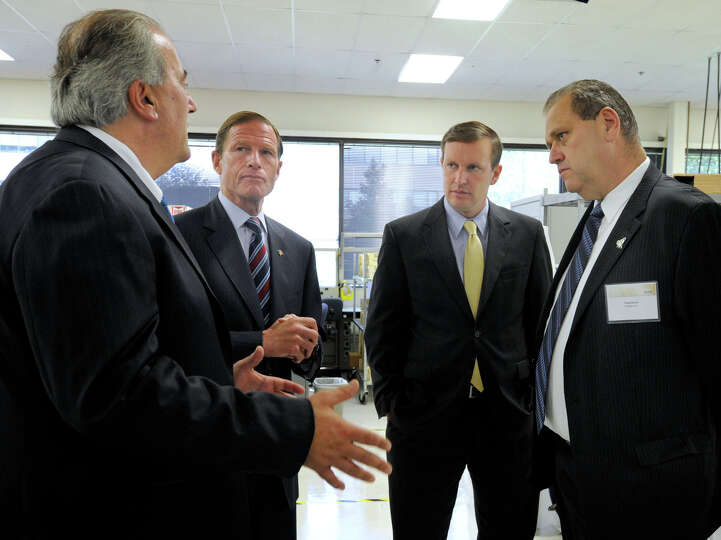 From left, Michael Parilla, senior vice president at Hologic, U.S. Sen. Richard Blumenthal, U.S. Rep