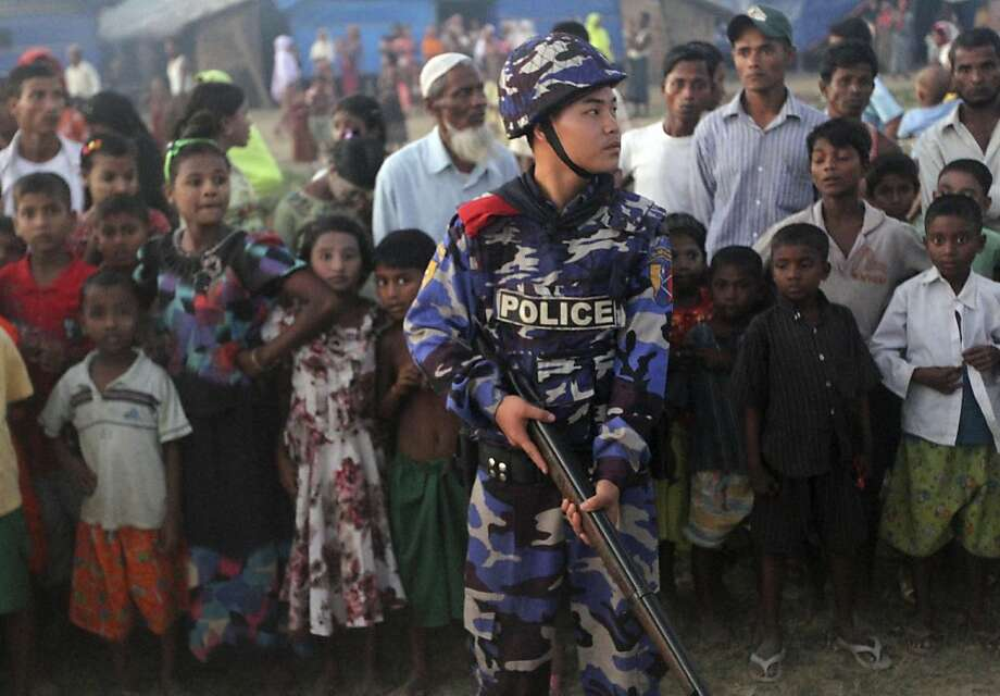 A police officer stands guard at a Muslim refugee camp in Sittwe, the capital of Rakhine state. Photo: Khin Maung Win, Associated Press