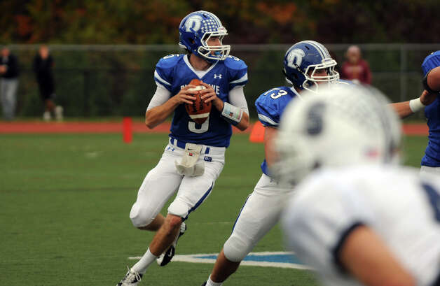 Staples' QB Henry Baldwin in action as Darien High School hosts Staples in a football game in Darien, Conn., Oct. 27, 2012. Photo: Keelin Daly