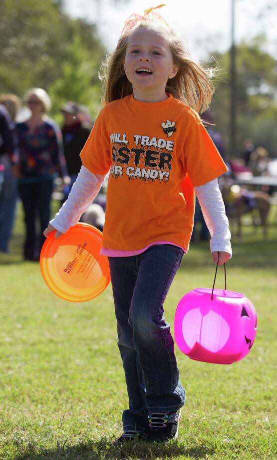 Abigail Collins, 6, walks around looking for candy at the fourth annual Howl-O-Ween Fest 2012 at Bridgeland's Oak Meadow Park in Cypress on Saturday, Oct. 27, 2012, in Houston. Photo: J. Patric Schneider, For The Chronicle / © 2012 Houston Chronicle