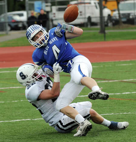 Staples' Joey Zelkowitz tackles and strips Darien's Jackson Whiting of the ball as Darien High School hosts Staples in a football game in Darien, Conn., Oct. 27, 2012. Photo: Keelin Daly