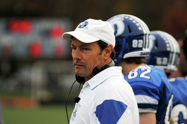 Darien Coach Rob Trifone watches as Darien High School hosts Staples in a football game in Darien, Conn., Oct. 27, 2012. Photo: Keelin Daly