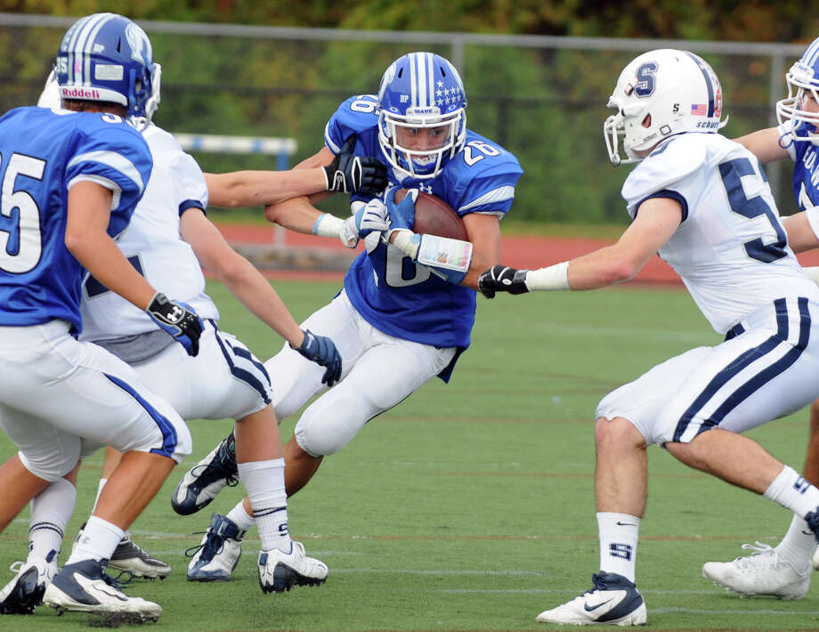 Darien's Peter Gesualdi in action as Darien High School hosts Staples in a football game in Darien, Conn., Oct. 27, 2012. Photo: Keelin Daly