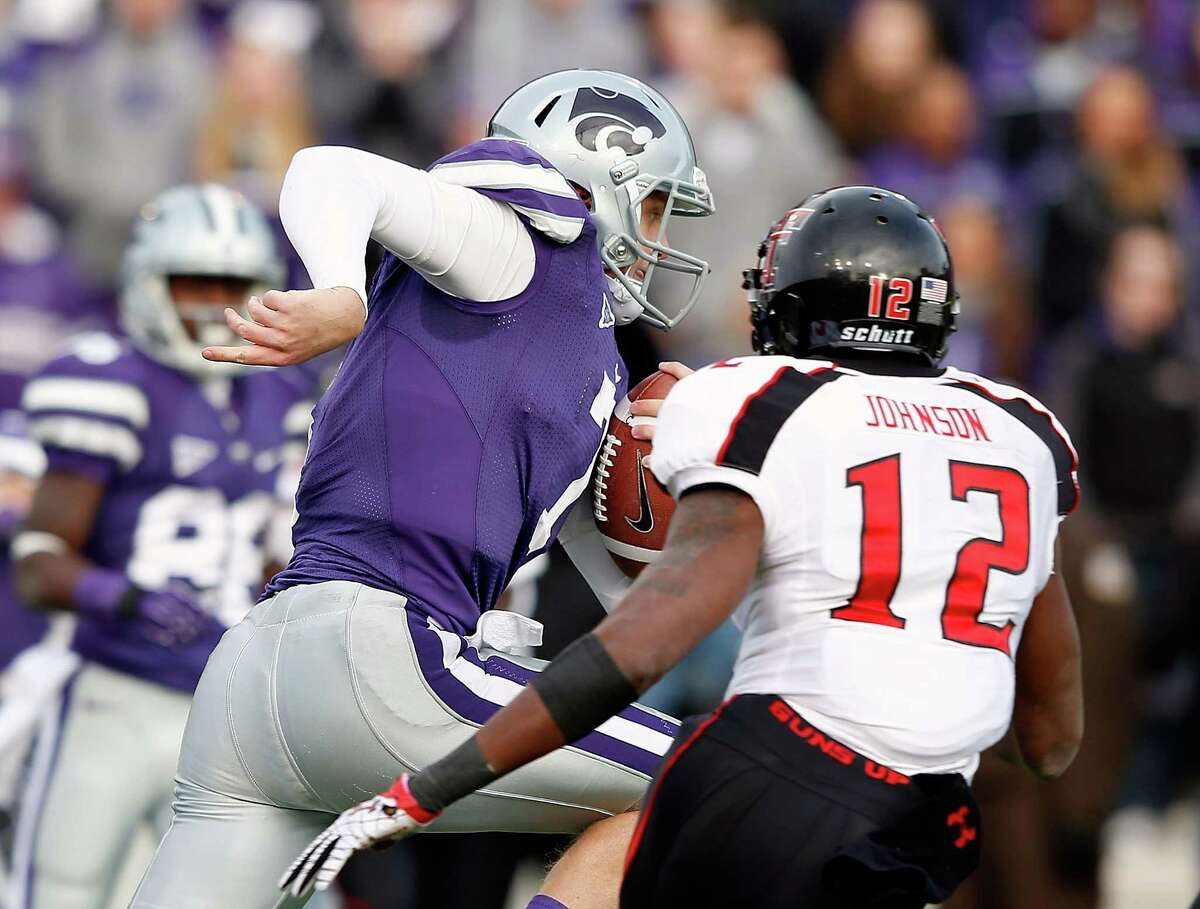 MANHATTAN, KS - OCTOBER 27: Quarterback Collin Klein #7 of the Kansas State Wildcats carries the ball past safety D.J. Johnson #12 of the Texas Tech Red Raiders on his way toward scoring a touchdown during the game at Bill Snyder Family Football Stadium on October 27, 2012 in Manhattan, Kansas.