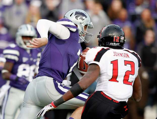 MANHATTAN, KS - OCTOBER 27:  Quarterback Collin Klein #7 of the Kansas State Wildcats carries the ball past safety D.J. Johnson #12 of the Texas Tech Red Raiders on his way toward scoring a touchdown during the game at Bill Snyder Family Football Stadium on October 27, 2012 in Manhattan, Kansas. Photo: Jamie Squire, Getty Images / Getty Images North America