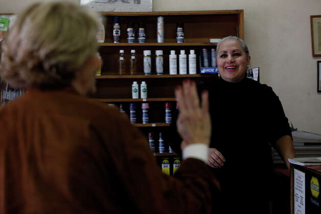 Longtime customer Janet Westheimer (left) waves goodbye to Stela Salazar on Central Shoe and Boot Repair's last day. Photo: Lisa Krantz, San Antonio Express-News / © 2012 San Antonio Express-News