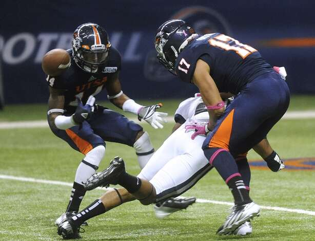 Safety Triston Wade (14) of UTSA prepares to intercept a deflected pass meant for Devonta Glover-Wright of Utah State as teammate Erik Brown (17) aproaches during WAC football action at the Alamodome on Saturday, Oct. 27, 2012. (Billy Calzada / San Antonio Express-News)