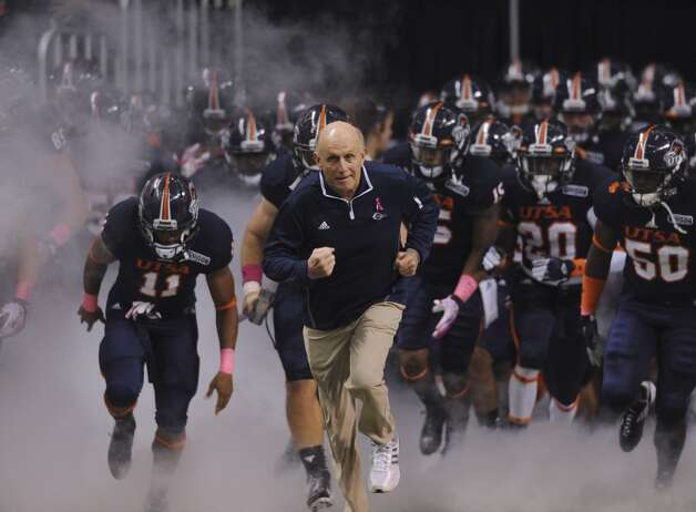 UTSA head coach Larry Coker leads his team out of the tunnel to face Utah State in WAC football action at the Alamodome on Saturday, Oct. 27, 2012. (Billy Calzada / San Antonio Express-News)