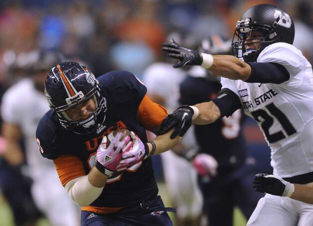 UTSA tight end Cole Hubble hauls in a long pass as Utah State's Brian Suite defends during WAC football action at the Alamodome on Saturday, Oct. 27, 2012. (Billy Calzada / San Antonio Express-News)