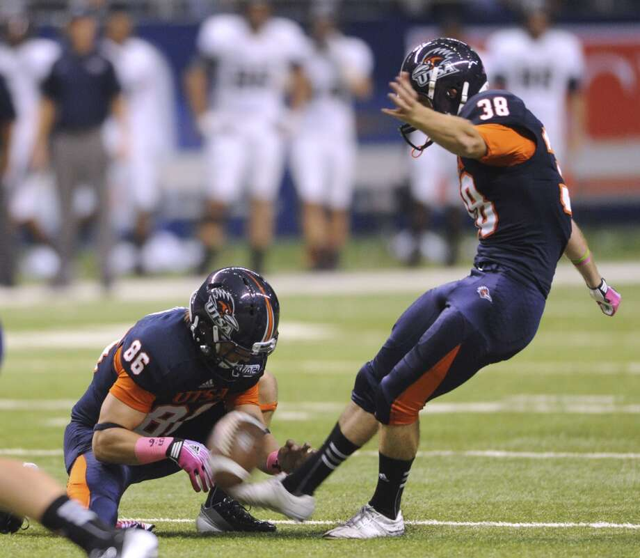 UTSA's Kristian Stern kicks a first-half field goal off of the hold of Seth Grubb during WAC football action at the Alamodome on Saturday, Oct. 27, 2012. (Billy Calzada / San Antonio Express-News)