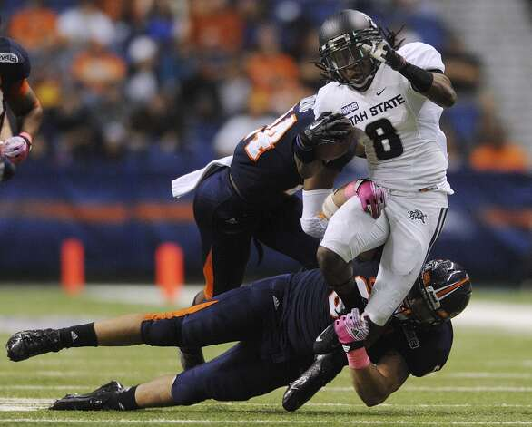 UTSA receiver Travis Reynolds is tackled by UTSA's Franky Anaya during WAC football action at the Alamodome on Saturday, Oct. 27, 2012. (Billy Calzada / San Antonio Express-News)